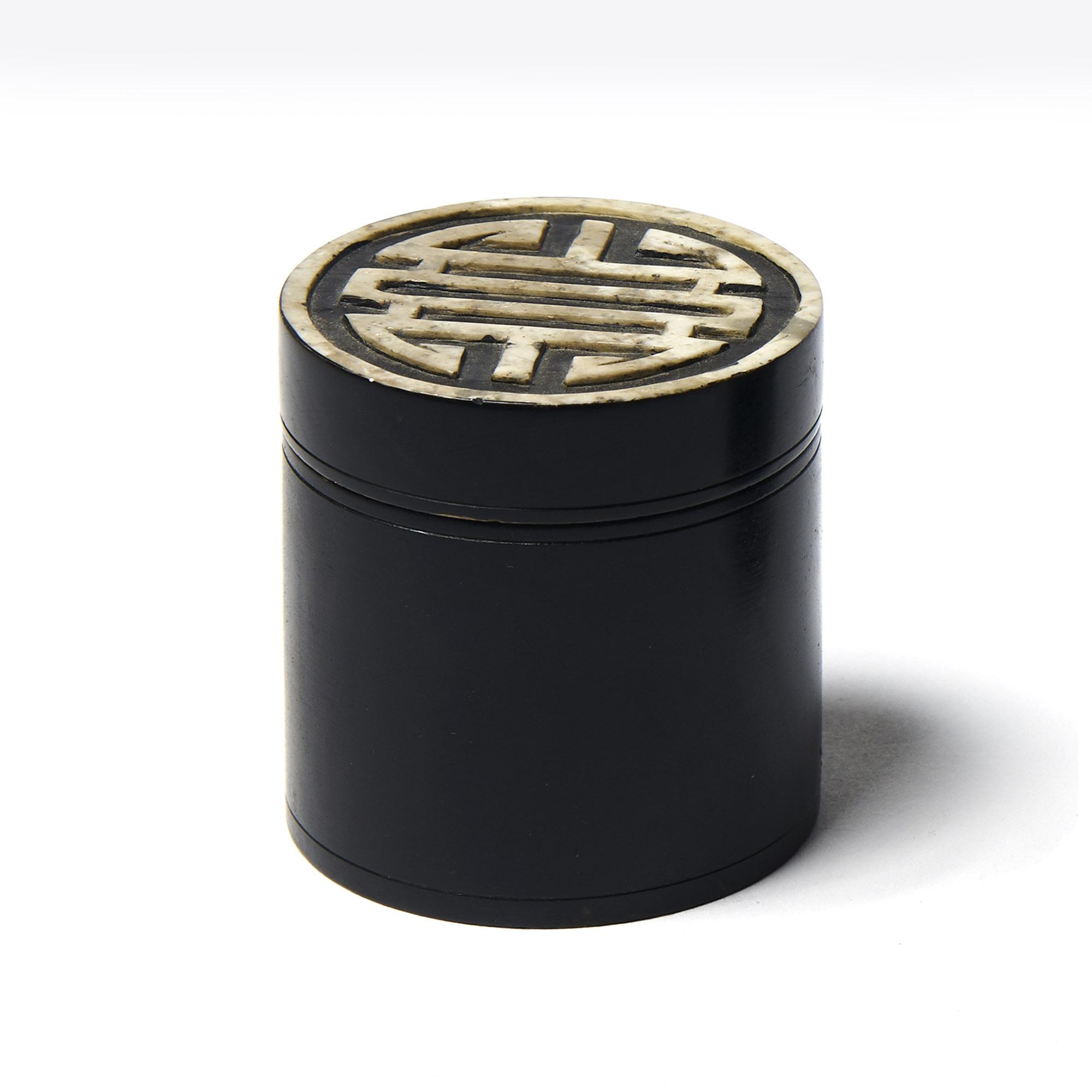 Caja piedra redonda negra símbolo